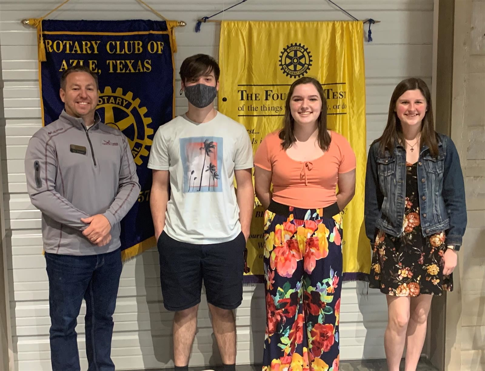 Rotary 4-Way Test Speech winners standing in front of Rotary Club flags